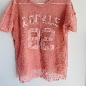 See through, mesh like T shirt. Great condition.